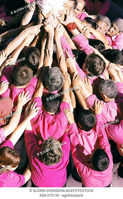 'Castellers' building human towers, a Catalan tradition. Sant Pere de Ribes. Barcelona province, Spain
