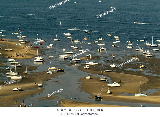 Boats moored at low tide in Arcachon Bay, Gironde, France