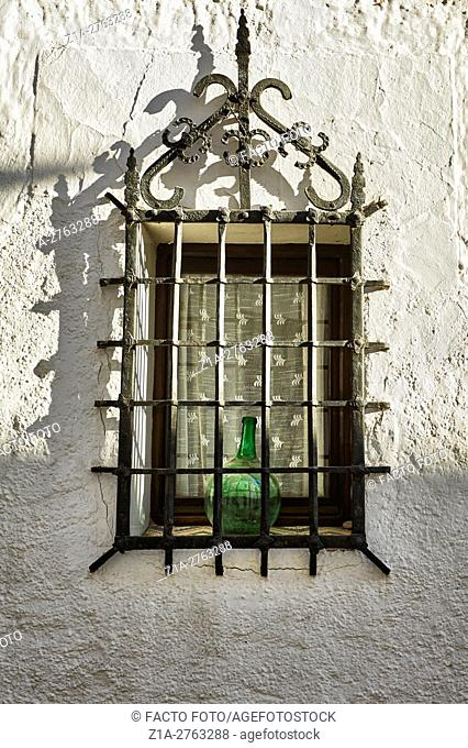 Grilled window in Altea. Alicante. Valencia community. Spain