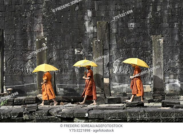 Buddhist monks at Bayon temple,Angkor Thom,Siem Reap,Cambodia,South east Asia