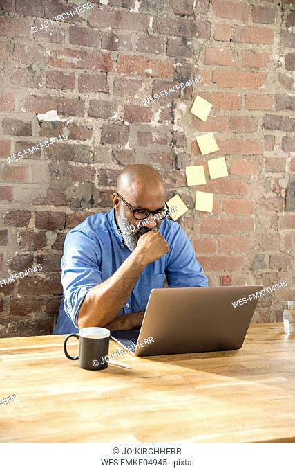 Businessman using laptop in the office