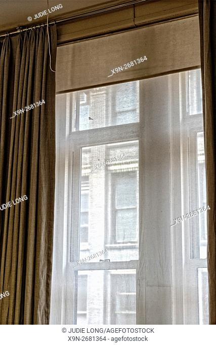 Manhattan, New York City - Looking Through Sheer Curtain Covered Window in the Flatiron District, at a Cast Iron Building Across the Street