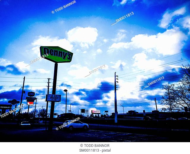 Denny's restaurant sign and parking lot