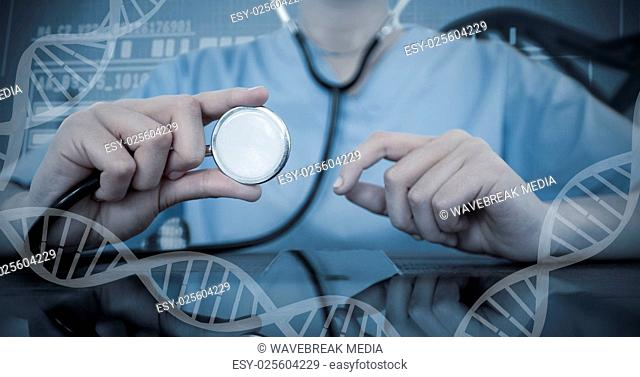 Composite image of mid-section of female doctor examining digital tablet with stethoscope