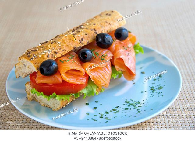 Mediterranean sandwich: smoked salmon, lettuce, tomato, black olives and wholemeal bread