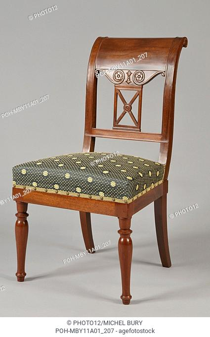 Mahogany chair with crook back In mahogany Circa 1803-1805 Private collection Decorated and sculpted with rosettes and volute ornaments Front turned legs and...