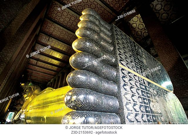 View of the Reclining Buddha in Wat Pho, a Buddhist temple in Bangkok, Thailand