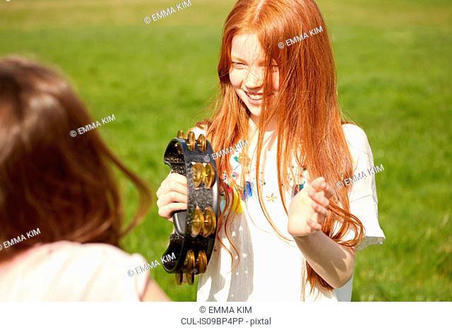 Girl playing tambourine