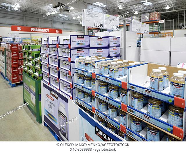 Vitamins and Kirkland brand food supplements at Costco Wholesale membership warehouse store pharmacy section. Fish oil and Coenzyme Q10 British Columbia, Canada