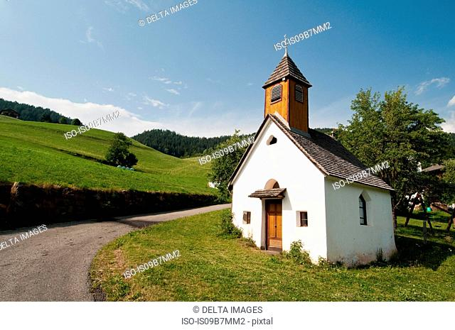 Rural road and San Pietro church, Funes Valley, Dolomites, Italy