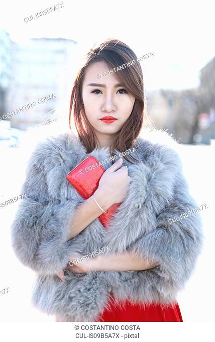 Young woman in fur coat, Milan, Italy