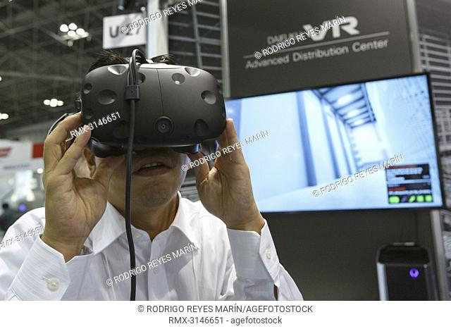 September 26, 2018, Tokyo, Japan - A visitor uses Daifuku's VR (Virtual Reality) technology to visualize automated warehouse gather during the New Values...