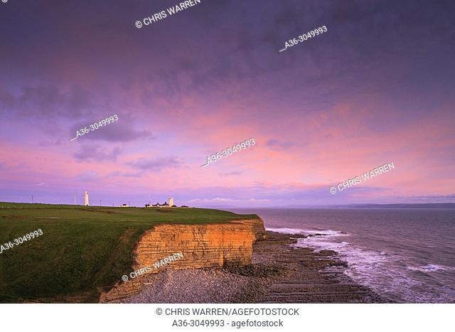 Nash Point Lighthouse near St Donats, Mid Glamorgan (Glamorgan Heritage Coast) Wales at sunset