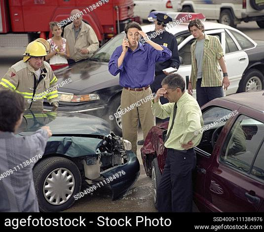 Hispanic man talking on cell phone at accident scene
