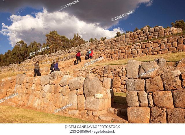Tourist walking at Chinchero ruins, Chinchero, Valle Sagrado, Cuzco, Peru, South America
