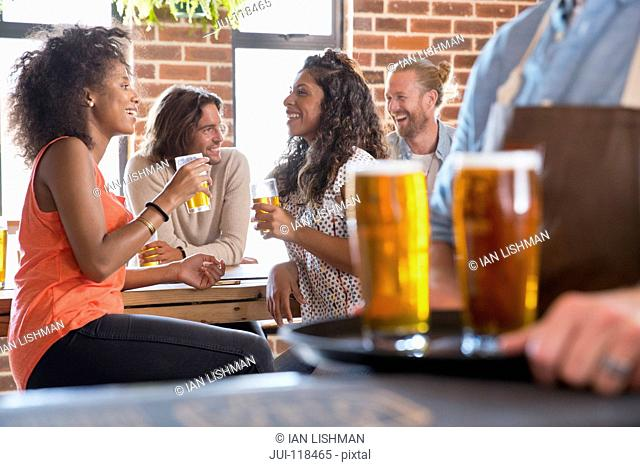 Two Female Friends Socializing In Bar Together
