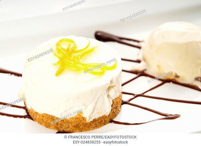 very elegant lemon mousse dessert served whith lemon peel on top and vanilla ice cream on side, MORE DELICIOUS FOOD ON PORTFOLIO