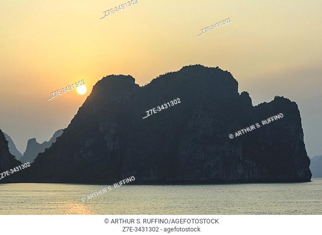 Ha Long Bay at sunset. Limestone karst topography. UNESCO World Heritage Site, Quang Ninh Province, Vietnam, Southeast Asia