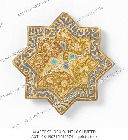 Star-shaped tile with an inscription and a bird, star-shaped tile made of quartz fritware, painted in underglaze blue, green-blue and luster with a text in...