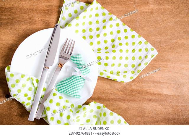 Spring Festive Table Setting for Easter Dinner with Cutlery and Napkin on Wooden Rustic Table. Selective Focus