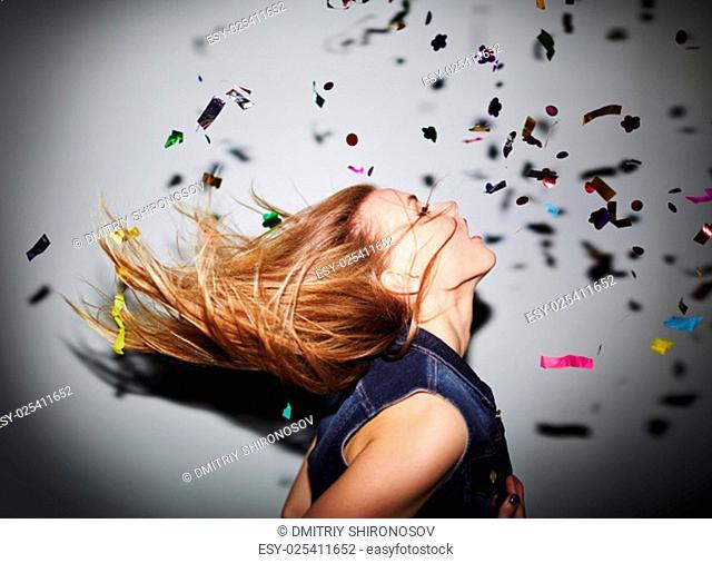 Energetic girl dancing in nightclub