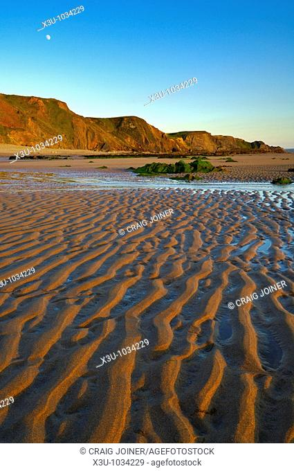Ripples left by the retreating tide at Sandymouth, Cornwall England