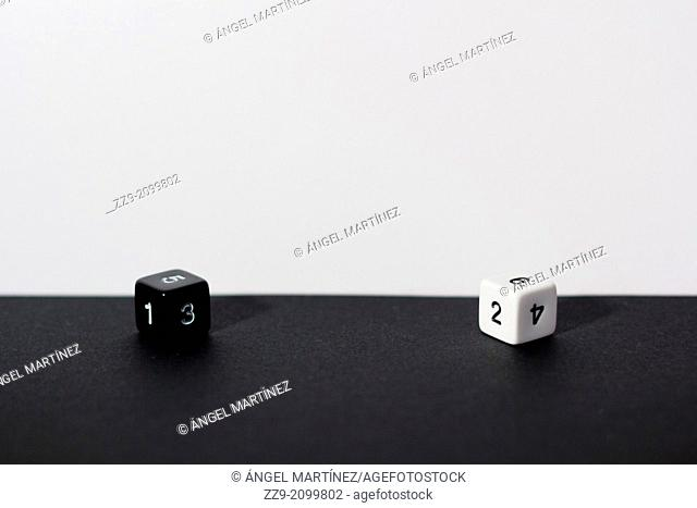 pair of dice, white and black