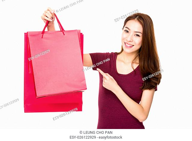 Woman with finger point to shopping bag