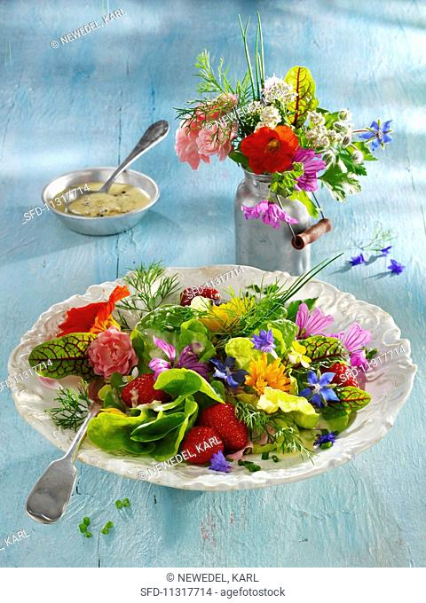 An edible flower salad with strawberries