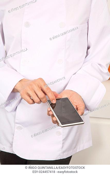 close up hands of chef woman with professional jacket using blank screen mobile phone