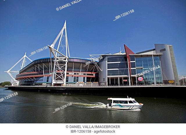 Millennium Stadium sports centre with boat on river, Cardiff, Wales, United Kingdom, Europe