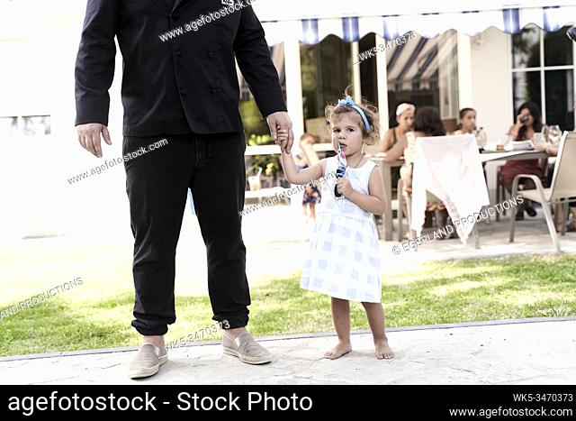 Father and daughter holding hands outdoors