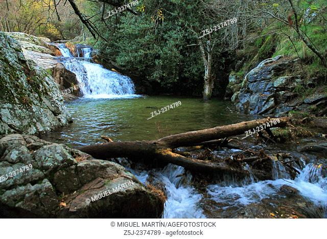 A large puddle close to the El Purgatorio falls, in the wild ravine carved by the Aguilón river, near Rascafría; this is one of the first tributaries of the...