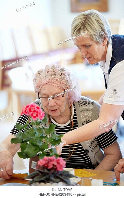Nurse with senior woman in care home