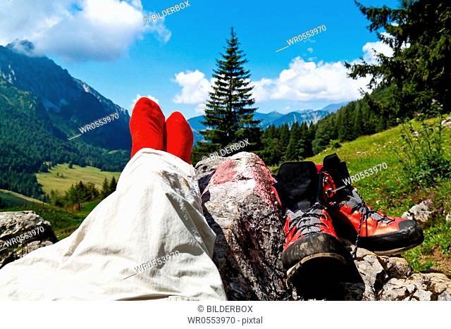 Red hiking boots on a hike in the mountains of Austria.Activity during leisure time