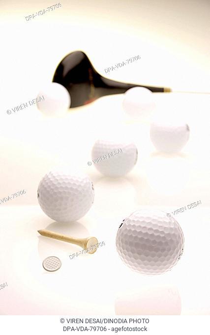 Golf balls six with golf club, marker tee