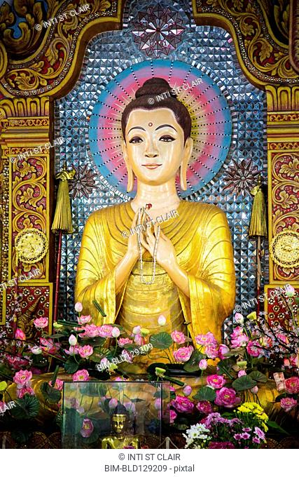 Buddha statue in Dhammikarama Burmese temple, George Town, Penang, Malaysia