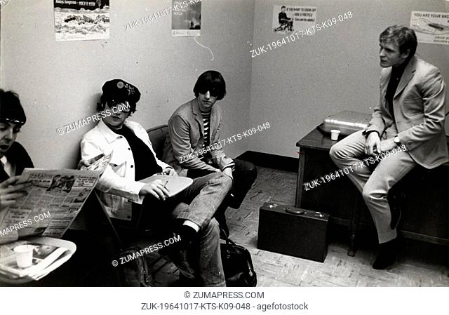 Oct. 17, 1964 - London, England, U.K. - The BEATLES music group's members, RINGO STARR, JOHN LENNON, and PAUL MCCARTNEY, sit and wait in a waiting room