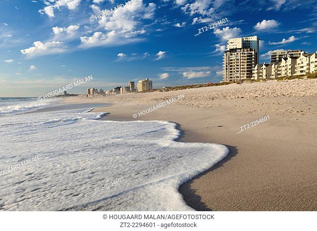 Wide angle photo of Bloubergstrand beachfront in warm sunlight. Bloubergstrand, Cape Town, South Africa