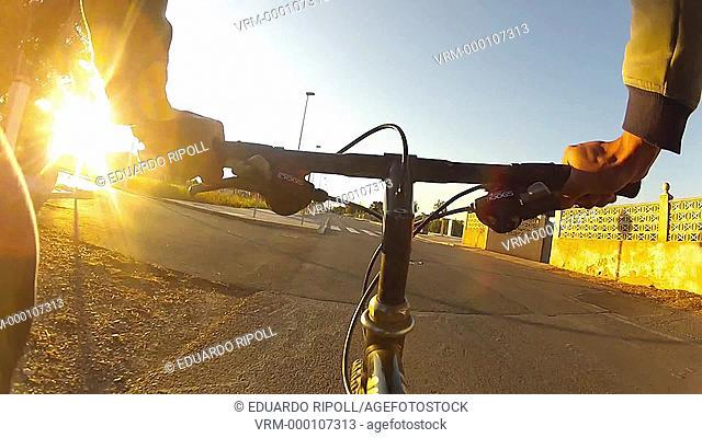 man riding a bike at the street