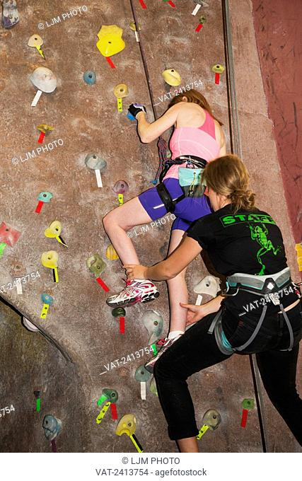 Woman with spinal cord injury rock climbing; Edmonton, Alberta, Canada