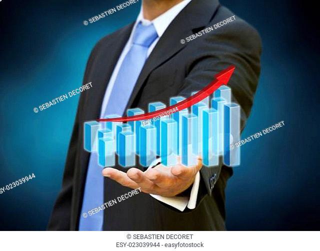 Businessman using digital graph