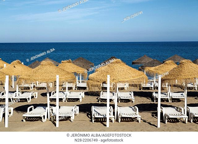 Sunbeds on the beach, Fuengirola, Malaga province, Costa del Sol, Andalusia, Spain