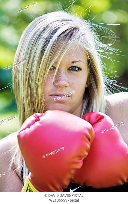 Teenage girl in boxing gloves