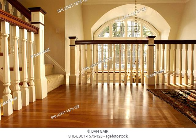 Traditional upstairs landing with birch hardwood floors