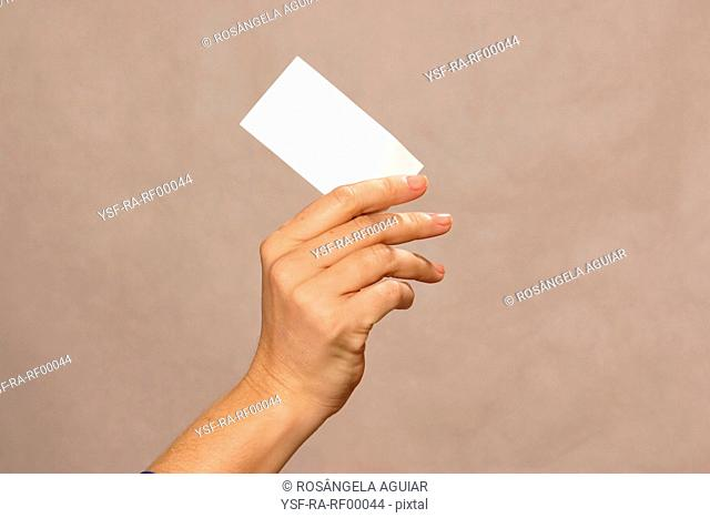 Female hand holding paper, Belém, Pará, Brazil