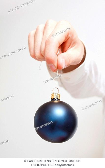 A man holding a christmas ornament