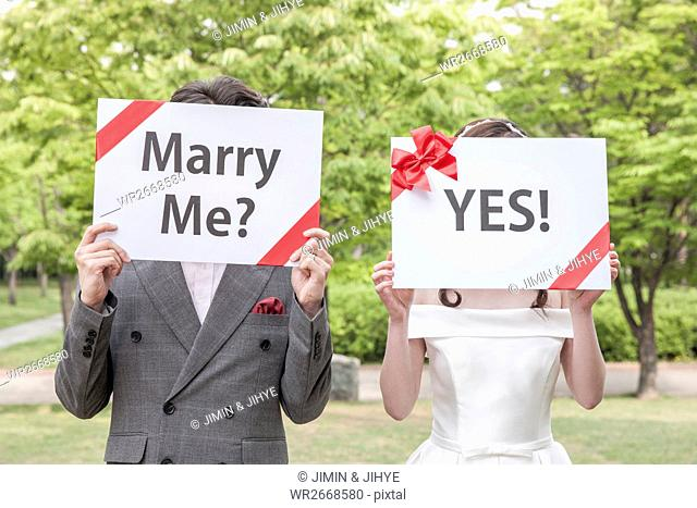 Young romantic couple with placards outdoors