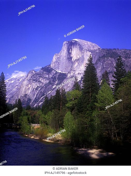 The Merced River running through the beautiful scenery of Yosemite National Park in the Sierra Nevada Mountains