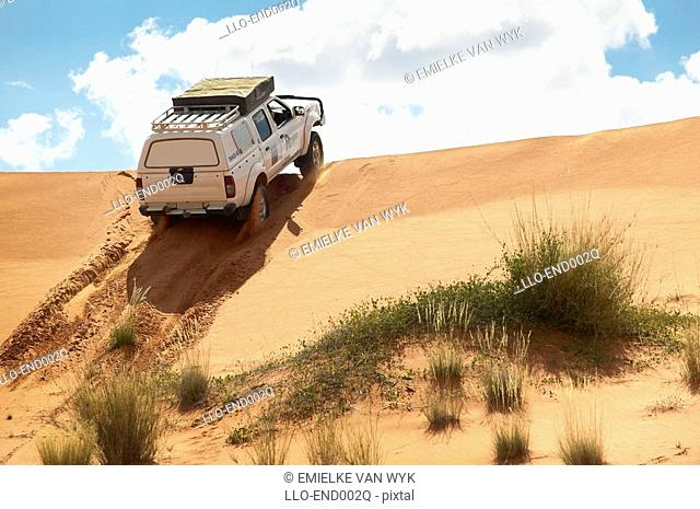 4x4 Cruising Over a Sand Dune - Low Angle  Namibia, Southern Africa